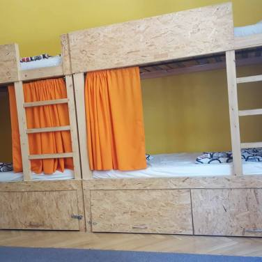 There were eight beds, each with their own lockers and power sockets.