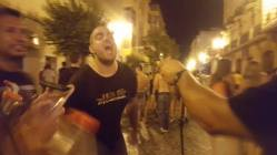 A man gets sprayed in the face with wine